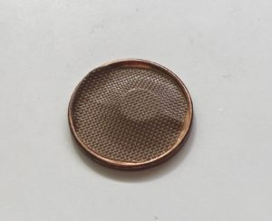 Penny shell magic trick